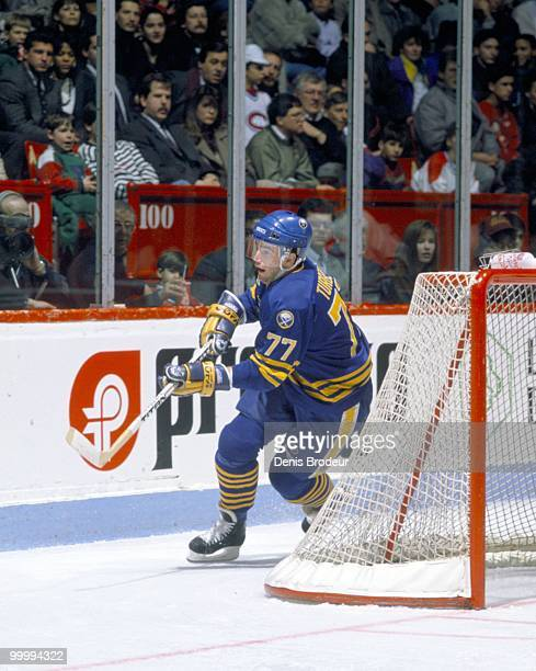 MONTREAL 1990's Pierre Turgeon of the Buffalo Sabres skates for the puck behind the net against the Montreal Canadiens in the early 1990's at the...