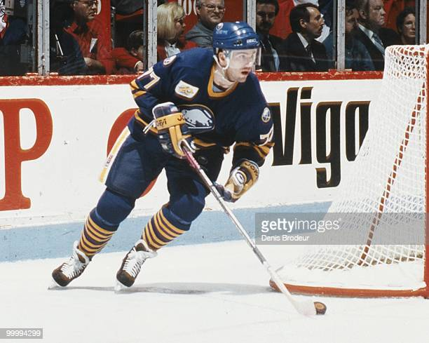 Pierre Turgeon of the Buffalo Sabres skates with the puck against the Montreal Canadiens in the early 1990's at the Montreal Forum in Montreal,...