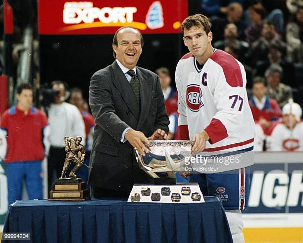 Pierre Turgeon of the Montreal Canadiens receives an award during the mid-1990's at the Montreal Forum in Montreal, Quebec, Canada. Turgeon played...