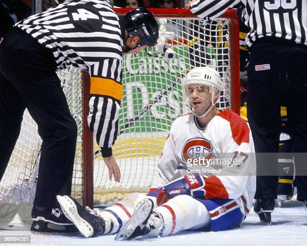 MONTREAL 1990's Pierre Turgeon of the Montreal Canadiens sits on the ice in front of the net during the mid1990's at the Montreal Forum in Montreal...
