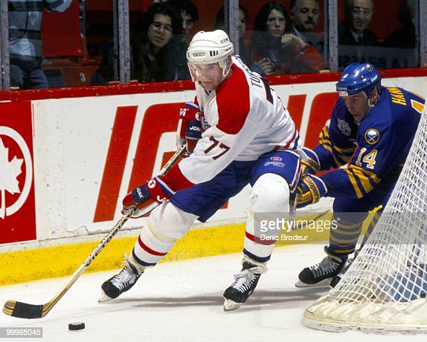 MONTREAL 1990's Pierre Turgeon of the Montreal Canadiens skates behind the net with puck possession during the mid1990's at the Montreal Forum in...