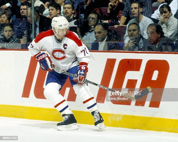 Pierre Turgeon of the Montreal Canadiens skates during the mid-1990's at the Montreal Forum in Montreal, Quebec, Canada. Turgeon played for the...