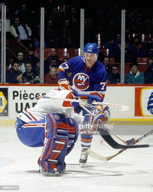 Pierre Turgeon of the New York Islanders skates against the Montreal Canadiens in the early 1990's at the Montreal Forum in Montreal, Quebec, Canada.