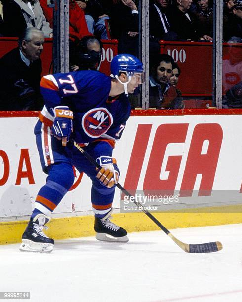 MONTREAL 1990's Pierre Turgeon of the New York Islanders skates against the Montreal Canadiens in the early 1990's at the Montreal Forum in Montreal...