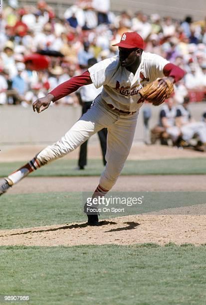 ST LOUIS MO CIRCA 1960's Pitcher Bob Gibson of the St Louis Cardinals follows through on a pitch circa late 1960's during a Major League Baseball...