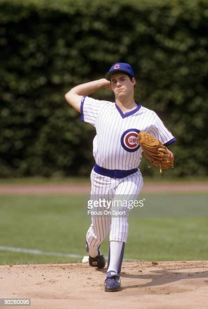 CHICAGO IL CIRCA 1980's Pitcher Greg Maddux of the Chicago Cubs warms up in the bullpen before circa 1980's in Chicago Illinois Maddux played for the...
