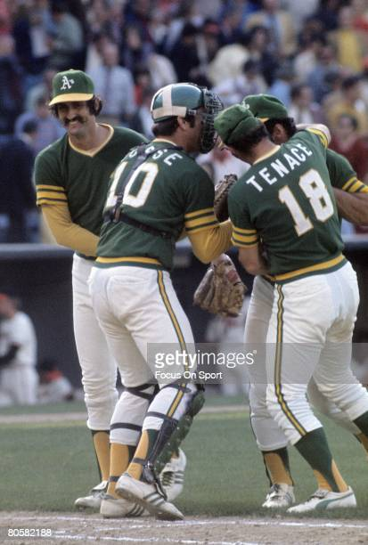 OAKLAND CA CIRCA 1970's Pitcher Rollie Fingers catcher Ray Fosse infielder Gene Tenace of the Oakland Athletics celebrates after a win of a circa...