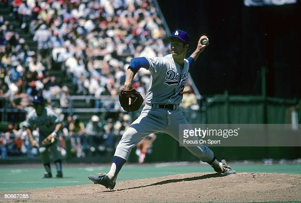CIRCA 1970's Pitcher Tommy John of the Los Angeles Dodgers pitches during a circa mid 1970's Major League Baseball game John played for the Dodgers...