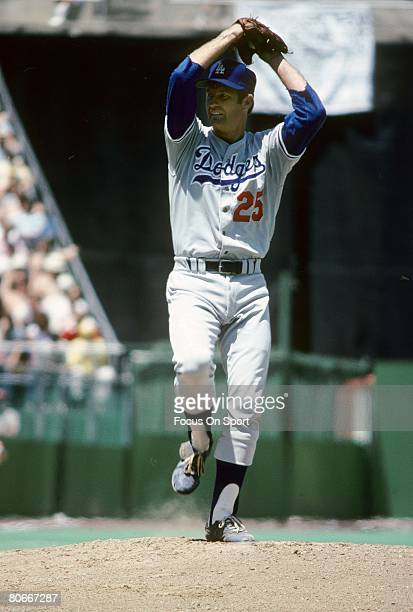 CIRCA 1970's Pitcher Tommy John of the Los Angeles Dodgers winds up to pitch during a circa mid 1970's Major League Baseball game John played for the...