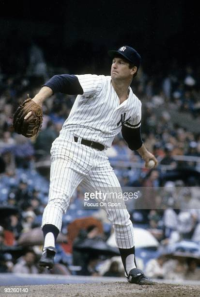 S: Pitcher Tommy John of the New York Yankees winds up to pitch during a circa 1980's Major League Baseball game at Yankee Stadium in Bronx, New...