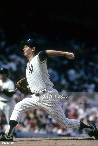 BRONX NY CIRCA 1980's Pitcher Tommy John of the New York Yankees winds up to pitch during a circa 1980's Major League Baseball game at Yankee Stadium...