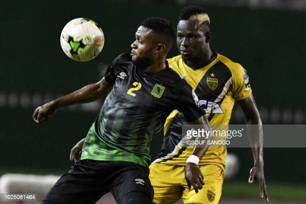 ASEC's player Willy Brasciano Ta Bi vies with As Vita club's player Emmanuel N'gudikama during the CAF Champions league football match between ASEC...
