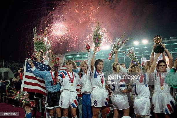 S players celebrate a 2-1 victory over China in the women's soccer tournament of the 1996 Summer Olympics.