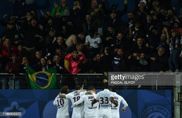 PSG's players celebrate after scoring a goal during the French L1 football match between Montpellier Herault Sport Club and Paris SaintGermain on...