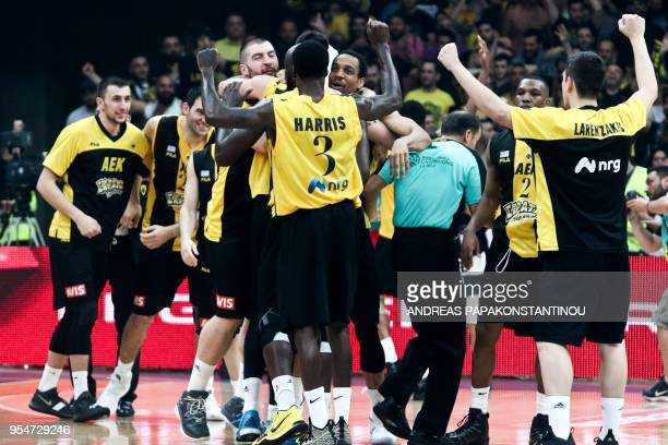 AEK's players celebrate after victory during the final four Champions League basketball game between AEK BC and UCAM Murcia at the OAKA Stadium in...