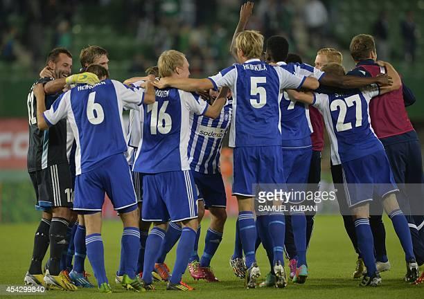 S players celebrate during the second leg play-off UEFA Europa League football match Rapid Wien vs HJK Helsinki in Vienna, Austria on August 28,...