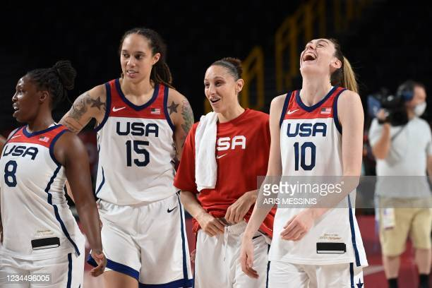 S players celebrate their win in the women's semi-final basketball match between USA and Serbia during the Tokyo 2020 Olympic Games at the Saitama...