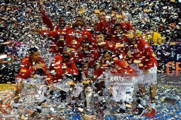 TOPSHOT USA's players celebrate with the trophy during the winner's ceremony after winning the FIBA Americas Championship final match against...
