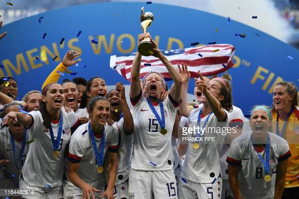 TOPSHOT USA's players including forward Megan Rapinoe celebrate with the trophy after the France 2019 Womens World Cup football final match between...
