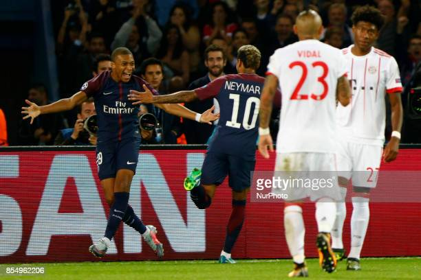 PSG's players Neymar Jr and Kylian Mbappe celebrate a goal during the UEFA Champions League football match between Paris SaintGermain and Bayern...
