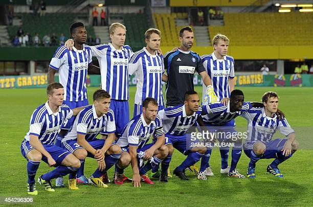S players pose for the team photo prior to the second leg play-off UEFA Europa League football match Rapid Wien vs HJK in Vienna, Austria on August...