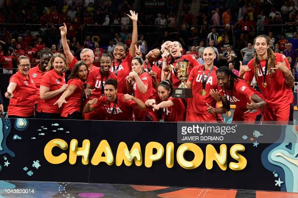 TOPSHOT USA's players pose with ther golden medals and the world cup trophy as they celebrate winning the FIBA 2018 Women's Basketball World Cup...