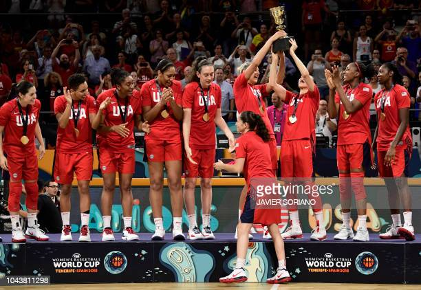 USA's players raise their world cup trophy after winning the FIBA 2018 Women's Basketball World Cup final match between Australia and United States...