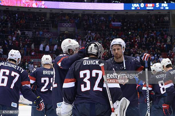 USA's players react after losing the Men's ice hockey Bronze Medal Game USA vs Finland at the Bolshoy Ice Dome during the Sochi Winter Olympics on...