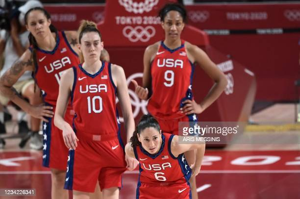 S players watch as they play in the women's preliminary round group B basketball match between Nigeria and USA during the Tokyo 2020 Olympic Games at...
