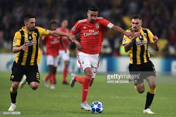 AEK's Portuguese midfielder Andre Simoes vies with Benfica's Portuguese defender Andre Almeida during their UEFA Champions League Group E football...
