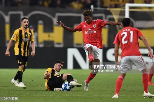 AEK's Portuguese midfielder Andre Simoes vies with Benfica's Portuguese midfielder Gedson Fernandes during their UEFA Champions League Group E...