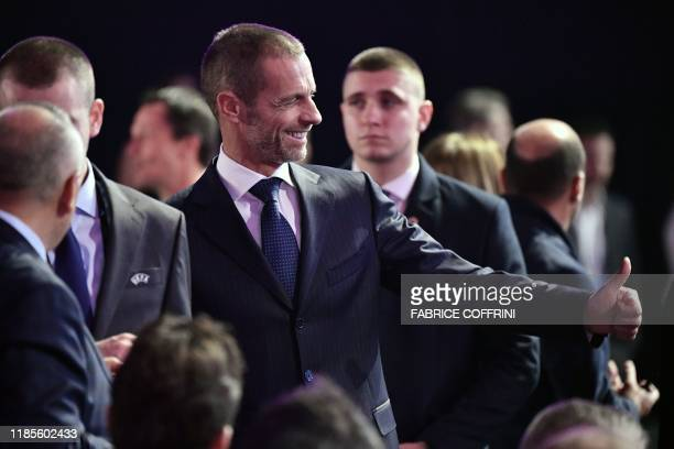 UEFA's president Aleksander Ceferin gives a thumb up as he arrives for the UEFA Euro 2020 football competition final draw in Bucharest on November 30...