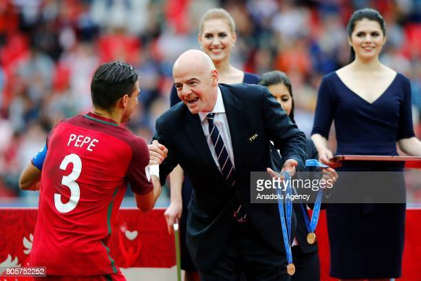 FIFA's President Gianni Infantino greets Portugal's Pepe for winning the FIFA Confederations Cup 2017 PlayOff for Third Place between Portugal and...