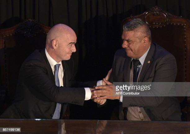 FIFA's President Gianni Infantino shakes hands with AFA's President Claudio Tapia at Argentine Football Assosiation head quarters in Buenos Aires on...