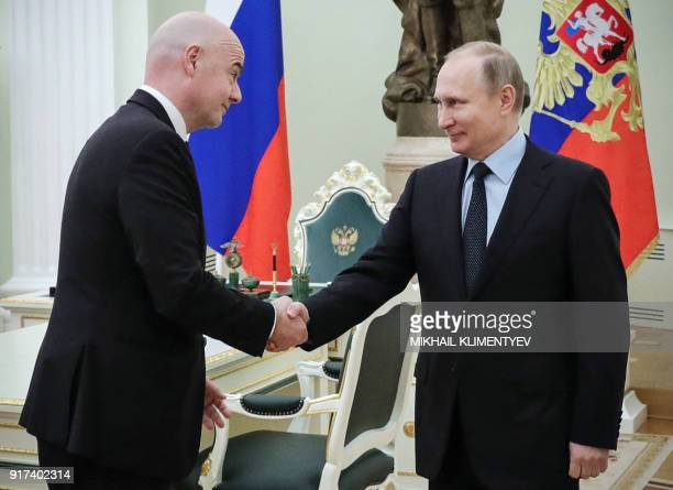 TOPSHOT FIFA's president Gianni Infantino shakes hands with Russian President Vladimir Putin during their meeting at the Kremlin in Moscow on...