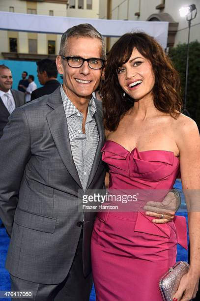HBO's president of programming Michael Lombardo with actress Carla Gugino at the Premiere Of HBO's 'The Brink' at Paramount Studios on June 8 2015 in...
