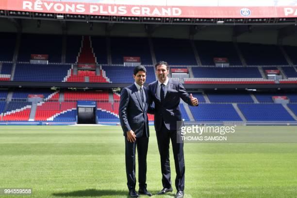 PSG's Qatari president Nasser AlKhelaifi and Italian goalkeeper Gianluigi Buffon pose for the press on July 9 2018 at the Parc des Princes stadium in...