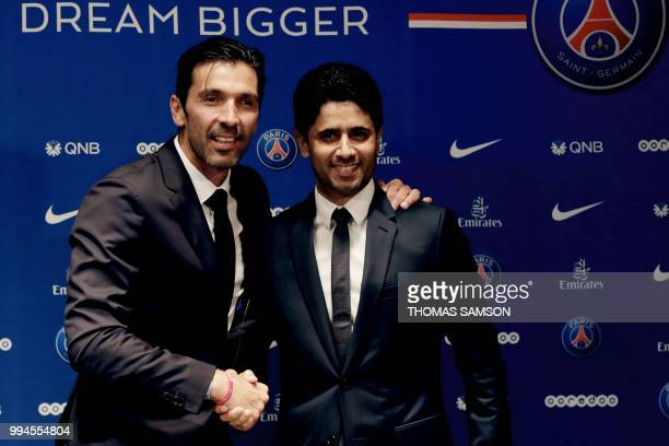 PSG's Qatari president Nasser AlKhelaifi shakes hand with Italian goalkeeper Gianluigi Buffon at the end of a press conference on July 9 2018 at the...