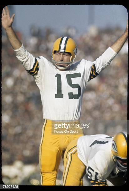 CIRCA 1960's Quarterback Bart Starr of the Green Bay Packers tries to quiet the crowd during a circa 1960's NFL game Starr played for the Packers...