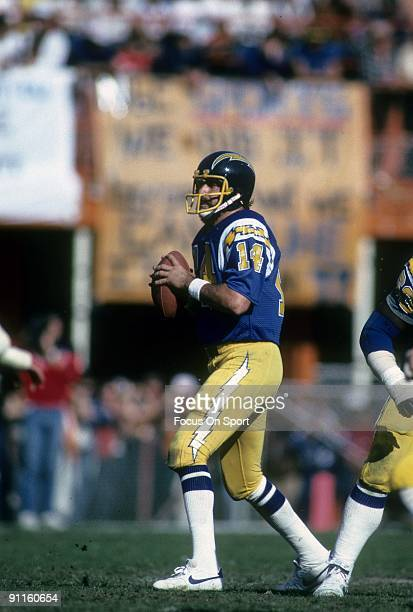 MIAMI FL CIRCA 1980's Quarterback Dan Fouts of the San Diego Chargers is back to pass against the Miami Dolphins during an NFL football game circa...