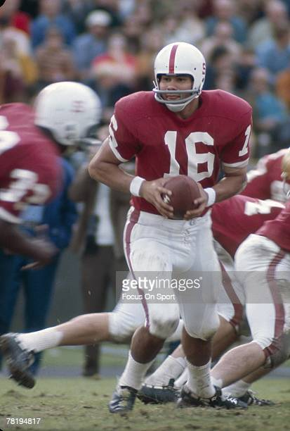 S: Quarterback Jim Plunkett of the Stanford Cardinals turns to hand the ball off during a early circa 1970's NCAA football game at Stanford Stadium...