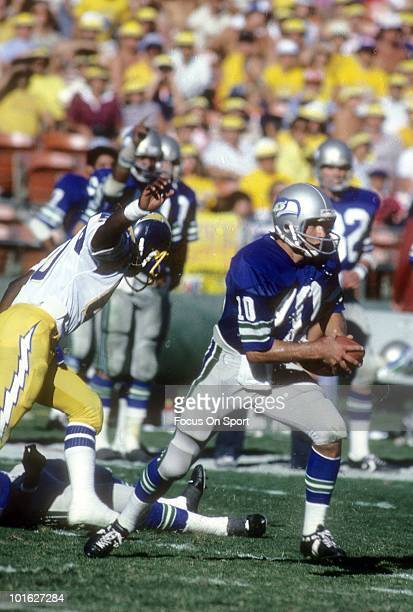 S: Quarterback Jim Zorn of the Seattle Seahawks in action scramble with the ball against the San Diego Chargers circa late 1970's during an NFL...
