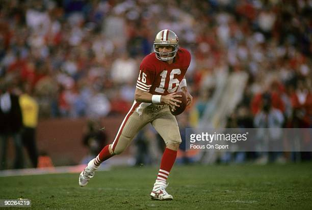 S: Quarterback Joe Montana of the San Francisco 49ers in action running with the ball during an NFL football game mid circa 1980's at Candlestick...