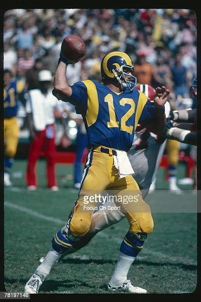 Quarterback Joe Namath of the Los Angeles Rams, drops back to pass against the Atlanta Falcons during mid circa 1970's NFL football game at the Los...