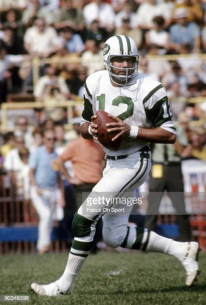 CIRCA 1970's Quarterback Joe Namath of the New York Jets in action drops back to pass during an early circa 1970's NFL football game Namath played...