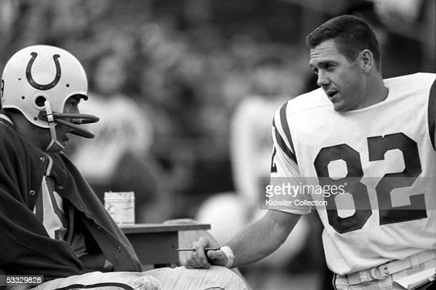 BALTIMORE 1960's Quarterback Johnny Unitas and wide receiver Raymond Berry of the Baltimore Colts talk on the sidelines during a game circa 1960's at...