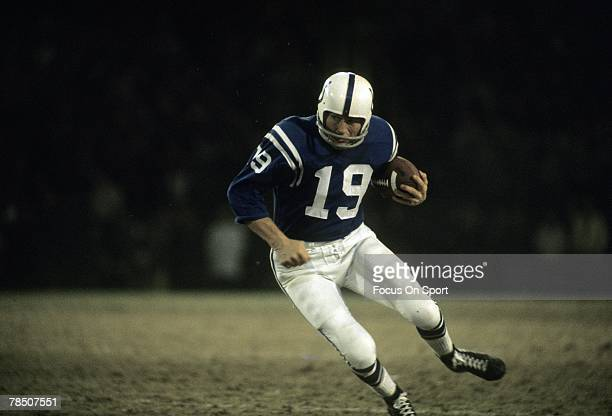BALTIMORE MD CIRCA 1960's Quarterback Johnny Unitas of the Baltimore Colts run with the ball during a late circa 1960's NFL football game at Memorial...