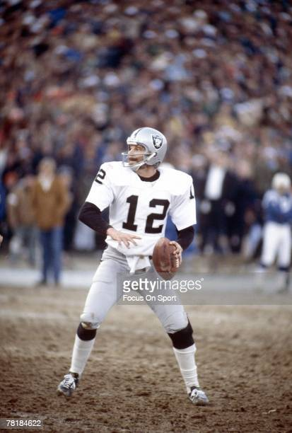 BALTIMORE MD CIRCA 1970's Quarterback Ken Stabler of the Oakland Raiders drops back to pass against the Baltimore Colts during a mid circa 1970's NFL...