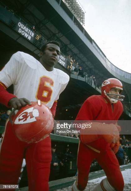 CIRCA 1970's Quarterback Len Dawson left of the Kansas City Chiefs runs on to the field during a early circa 1970's NFL football game Dawson played...