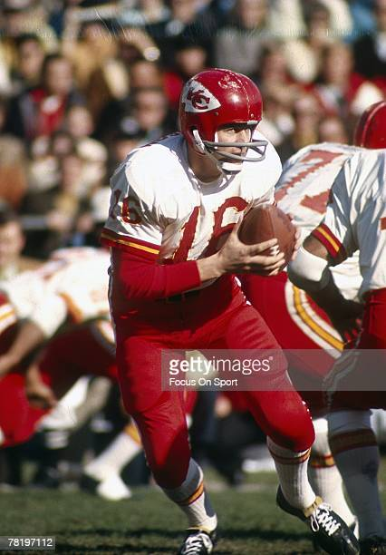 OAKLAND CA CIRCA 1970's Quarterback Len Dawson of the Kansas City Chiefs drops back to pass against the Oakland Raiders during an early circa 1970's...